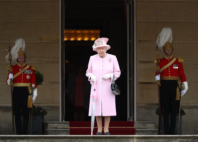 Britain's Queen Elizabeth II arrives at the Queen's Garden Party in Buckingham Palace, central London on May 29, 2019. (Photo by Yui Mok / POOL / AFP) (Photo credit should read YUI MOK/AFP via Getty Images)