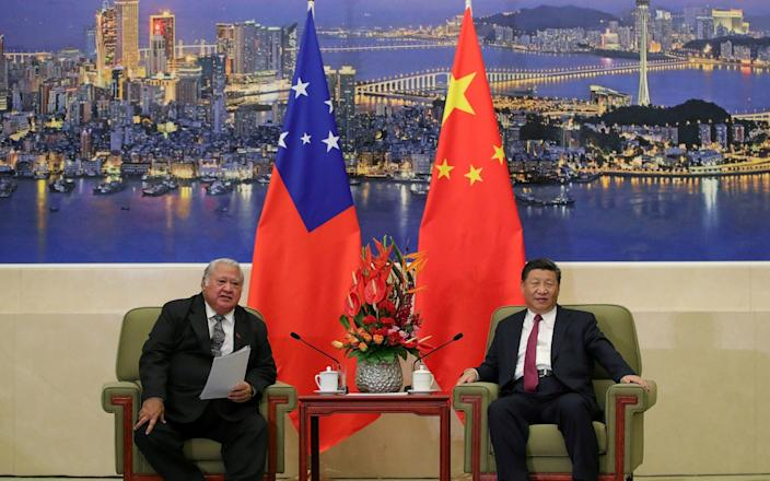 Samoa's Prime Minister Tuilaepa Lupesoliai Sailele Malielegaoi meets with China's President Xi Jinping at The Great Hall Of The People in Beijing, China - Lintao Zhang/REUTERS