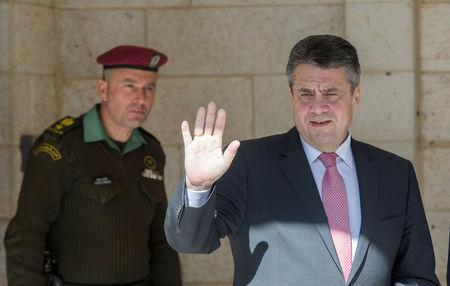 Germany's Foreign Minister Sigmar Gabriel waves upon his arrival for a meeting with Palestinian President Mahmoud Abbas, in the West Bank city of Ramallah January 31, 2018. REUTERS/Atef Safadi/Pool