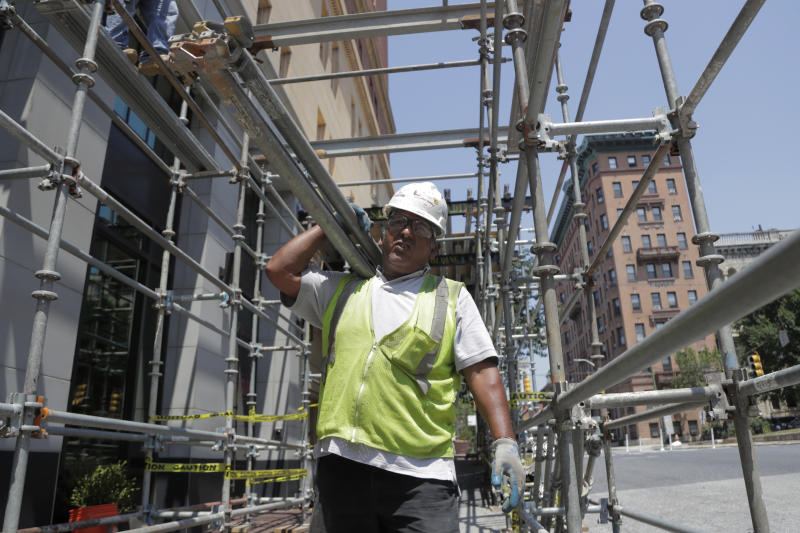 "A construction worker carries bars while helping build a scaffolding on the side of a hotel in the Mount Vernon section of Baltimore. In the latest rhetorical shot at lawmakers of color, President Donald Trump over the weekend vilified  Rep. Elijah Cummings majority-black Baltimore district as a ""disgusting, rat and rodent infested mess"" where ""no human being would want to live."" (AP Photo/Julio Cortez)"