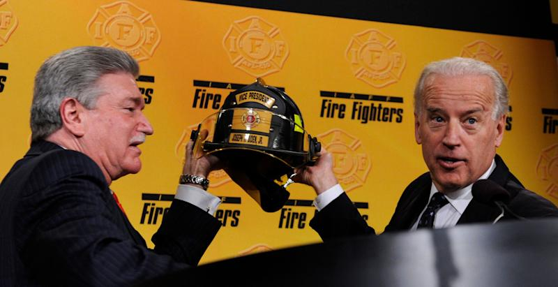 International Association of Fire Fighters General President Harold A. Schaitberger, left, and Vice President Joe Biden hold up a helmet that he was presented with after his remarks at the International Association of Fire Fighters 2009 Legislative Conference in Washington, Monday, March 16, 2009. (AP Photo/Susan Walsh)