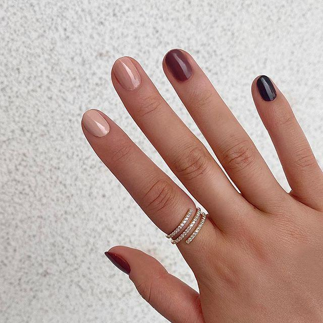 """<p>Ombré manicures are going strong this winter. There's no better way to keep this chic trend going all season long than to use warm, chocolate-y colors. </p><p><a class=""""body-btn-link"""" href=""""https://go.redirectingat.com?id=74968X1596630&url=https%3A%2F%2Foliveandjune.com%2Fproducts%2Fpumpkin-spice-latte%3Fvariant%3D31941195595818%26currency%3DUSD&sref=https%3A%2F%2Fwww.goodhousekeeping.com%2Fbeauty%2Fnails%2Fg29072953%2Fwinter-nail-designs%2F"""" target=""""_blank"""">SHOP WARM BROWN POLISHES</a></p><p><a href=""""https://www.instagram.com/p/CE9muumnw0-/&hidecaption=true"""">See the original post on Instagram</a></p>"""