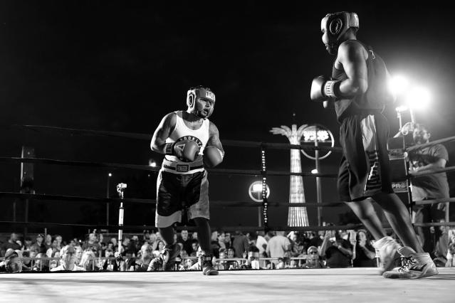 <p>Brooklyn South police officer Nelson Cordero, left, takes on Spiderman in the ring, with the Parachute Jump on the Coney Island boardwalk looming in the background. Their clash was part of the Brooklyn Smoker on Aug. 24, 2017. (Photo: Gordon Donovan/Yahoo News) </p>