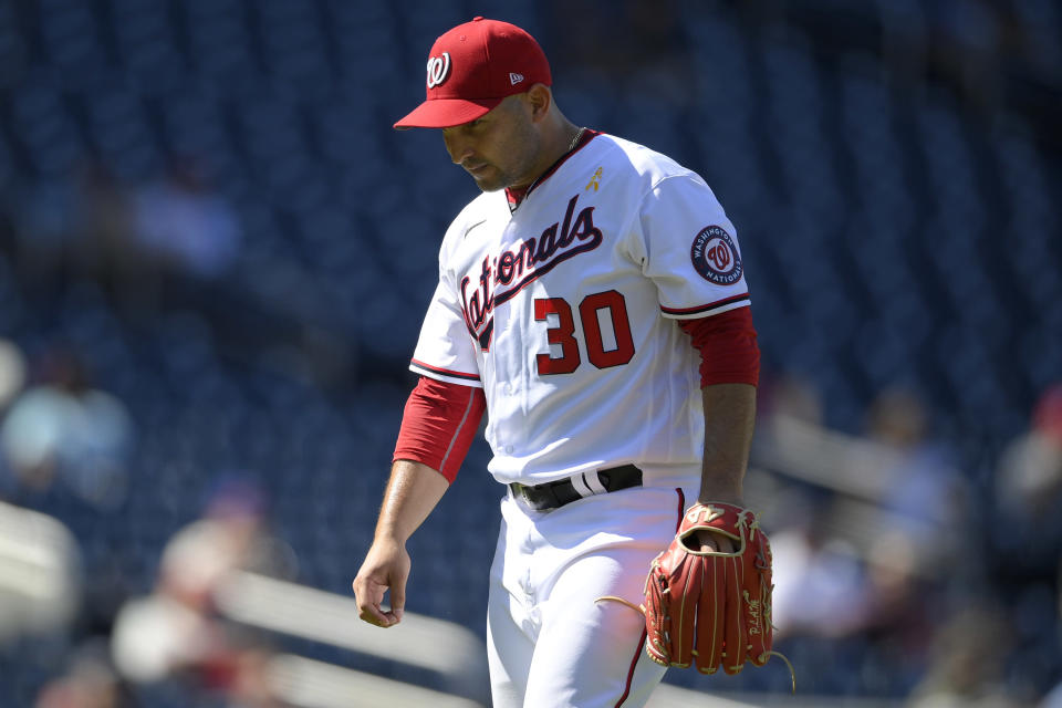 Washington Nationals starting pitcher Paolo Espino walks back to the dugout after he was pulled during the sixth inning of a baseball game against the Philadelphia Phillies, Thursday, Sept. 2, 2021, in Washington. (AP Photo/Nick Wass)