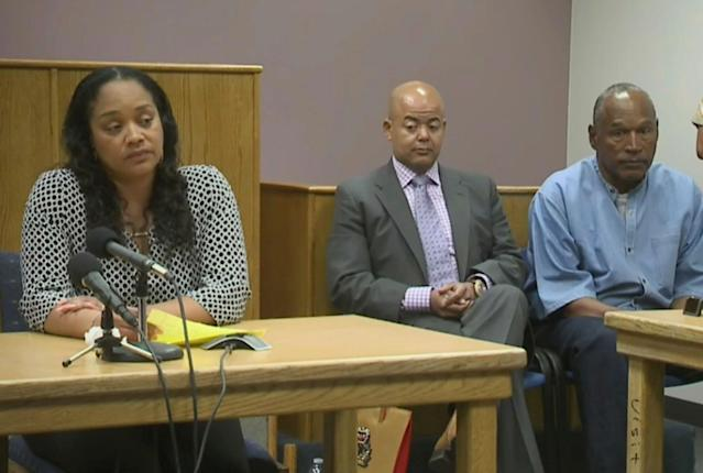 <p>Arnelle Simpson, left, testifies for her father, former NFL football star O.J. Simpson, far right, as attorney, Malcolm LaVergne, center, listens during O.J. Simpson's hearing at the Lovelock Correctional Center in Lovelock, Nev., on Thursday, July 20, 2017. Simpson was convicted in 2008 of enlisting some men he barely knew, including two who had guns, to retrieve from two sports collectibles sellers some items that Simpson said were stolen from him a decade earlier. (KOLO-TV via AP, POOL) </p>