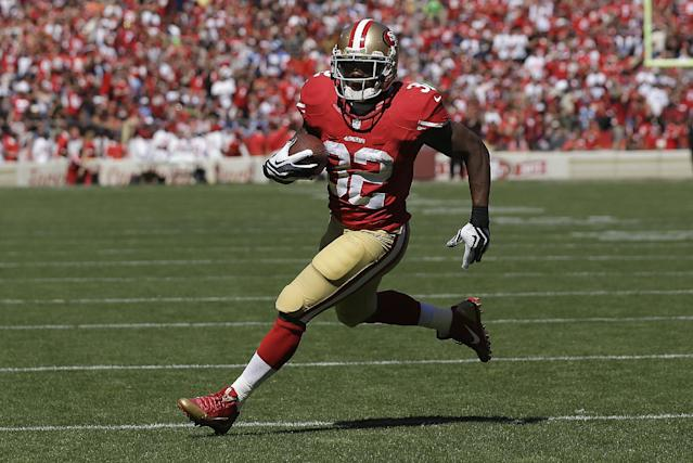 San Francisco 49ers running back Kendall Hunter (32) runs for a 13-yard touchdown against the Indianapolis Colts during the first quarter of an NFL football game in San Francisco, Sunday, Sept. 22, 2013. (AP Photo/Marcio Jose Sanchez)