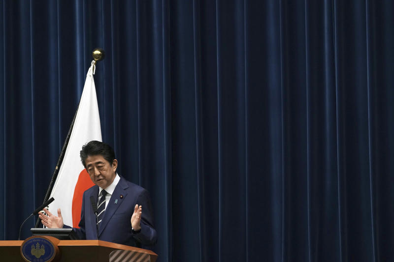 Japanese Prime Minister Shinzo Abe delivers his speech at the Prime Minister's office in Tokyo Saturday, Feb. 29, 2020. During the speech Abe said that his government will create another emergency package totaling over 270 billion yen ($2.5 billion) from reserve funds to prevent the spread of the new coronavirus, local media said. (AP Photo/Eugene Hoshiko)