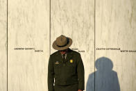 A National Park Service ranger stands in front of the Wall of Names at the Flight 93 National Memorial in Shanksville, Pa. before a Service of Remembrance Saturday, Sept. 11, 2021, as the nation marks the 20th anniversary of the Sept. 11, 2001 attacks. (AP Photo/Gene J. Puskar)