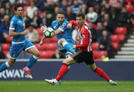 Britain Football Soccer - Sunderland v AFC Bournemouth - Premier League - Stadium of Light - 29/4/17 Sunderland's Donald Love in action with Bournemouth's Marc Pugh Reuters / Scott Heppell Livepic