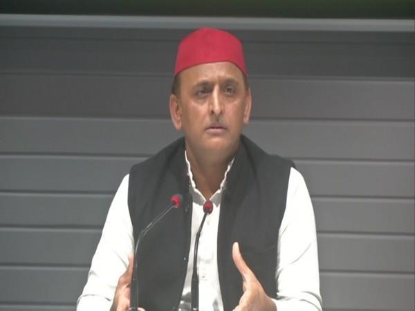 SP leader Akhilesh Yadav addressing a press conference in Lucknow on Monday.
