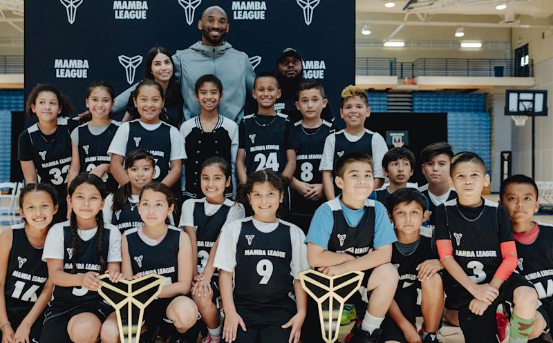 Kobe Bryant poses with some of the Mamba League's players. (Courtesy of Nike)
