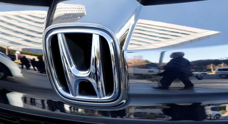 Honda cuts profit, sales outlook to four-year low; unveils $915 million buyback