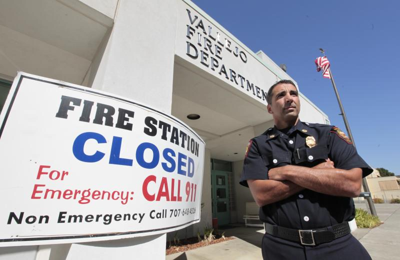 In this photo taken Tuesday, July 17, 2012, Vallejo fire chief Paige Meyer is seen outside a fire station closed after the city filed for bankruptcy in 2008. The city emerged from bankruptcy last year and offers an example for what can come, both good and bad, from the experience. Some in the community say bankruptcy was the city's only option to climb out of a financial hole while others say more could have been done to avoid it.(AP Photo/Rich Pedroncelli)