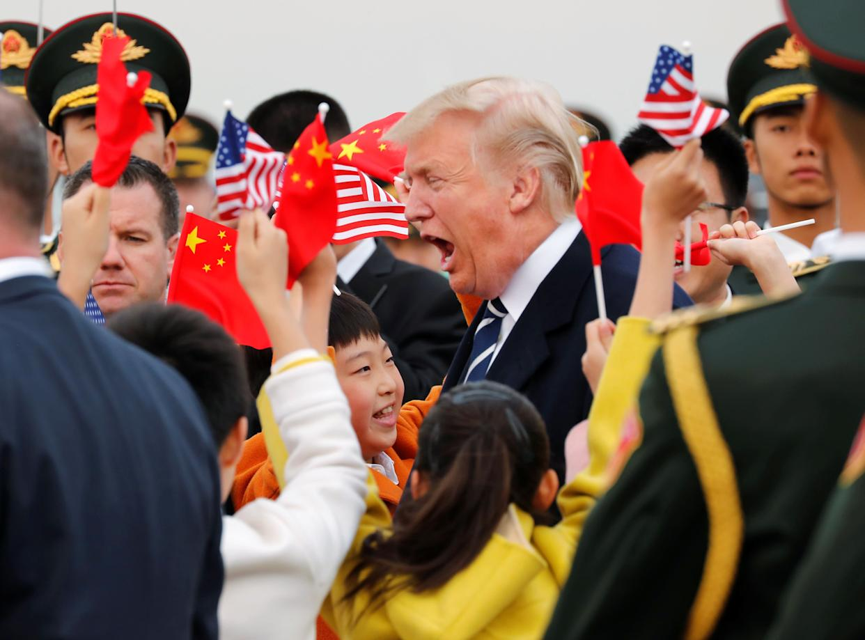 President Donald Trump and first lady Melania arrive on Air Force One at Beijing, China.