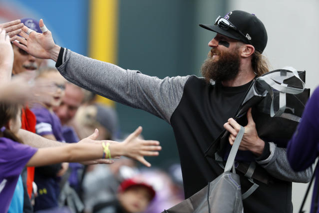 Charlie Blackmon is staying in Colorado. (AP Photo/David Zalubowski)