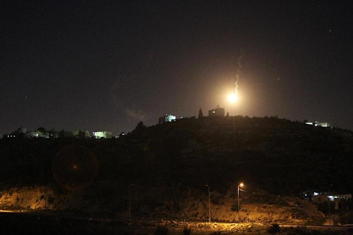 A picture taken from the Palestinian village of Dahriya, shows a flare lighting up the sky in the area of the Otniel Jewish settlement as security forces search for a Palestinian suspected of stabbing to death Dafna Meir, January 17, 2016 (AFP Photo/Hazem Bader)