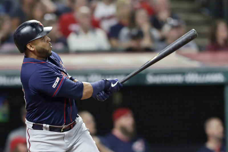 Minnesota Twins' Nelson Cruz watches his ball after hitting a two-run home run in the sixth inning in the second game of a baseball doubleheader against the Cleveland Indians, Saturday, Sept. 14, 2019, in Cleveland. (AP Photo/Tony Dejak)