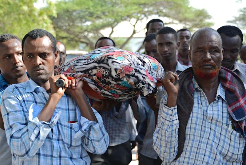 Relatives and fellow journalists carry the body of Somali journalist Mohamed Mohamud Timacade, on October 27, 2013, during his funeral in the capital Mogadishu after he succumbed to bullet injuries at a hospital