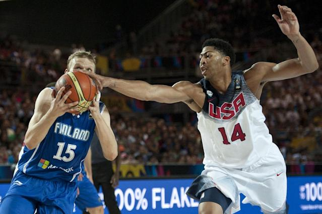 United States's Anthony Davis, right, duels for the ball beside Finland's Antero Lehto, during the Group C Basketball World Cup match between United States and Finland, in Bilbao northern Spain, Saturday, Aug. 30, 2014. The 2014 Basketball World Cup competition will take place in various cities in Spain from Aug. 30 through to Sept. 14. (AP Photo/Alvaro Barrientos)