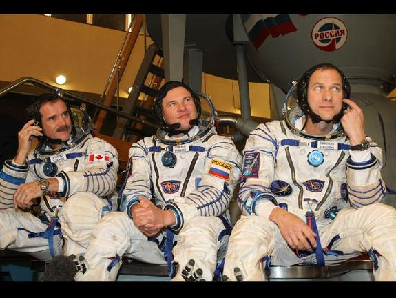 Expedition 34 Flight Engineer Chris Hadfield of the Canadian Space Agency (left), Soyuz Commander Roman Romanenko (center) and NASA Flight Engineer Tom Marshburn (right) are scheduled to launch Dec. 19 from the Baikonur Cosmodrome in Kazakhstan