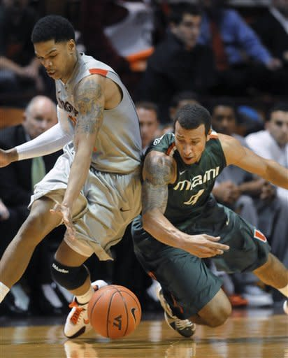 Miami's Trey McKinney, right, and Virginia Tech's Jarell Eddie go for a loose ball during the first half of an NCAA college basketball game Wednesday, Jan. 30, 2013, at Cassell Coliseum in Blacksburg, Va. (AP Photo/Don Petersen)