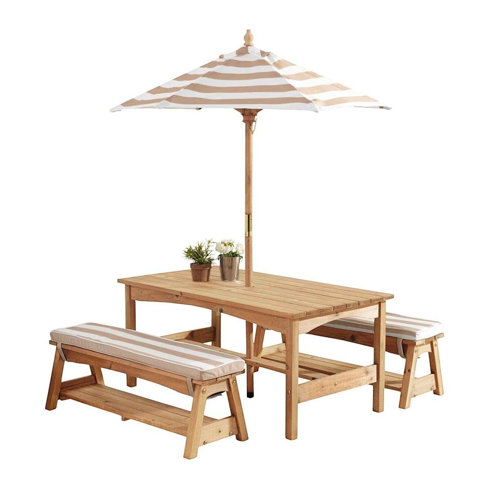 """<p><a class=""""link rapid-noclick-resp"""" href=""""https://www.amazon.com/KidKraft-Outdoor-Cushions-Umbrella-Espresso/dp/B00RGBFHYU/ref=sr_1_20?tag=syn-yahoo-20&ascsubtag=%5Bartid%7C10050.g.32462744%5Bsrc%7Cyahoo-us"""" rel=""""nofollow noopener"""" target=""""_blank"""" data-ylk=""""slk:SHOP NOW"""">SHOP NOW</a></p><p>Featuring cabana-stripe cushions and a coordinating umbrella, this KidKraft combo is so sophisticated, you'll find yourself double-checking the dimensions (42""""L x 19""""H). The benches also serve as storage for sidewalk chalk and other all-weather games.</p>"""