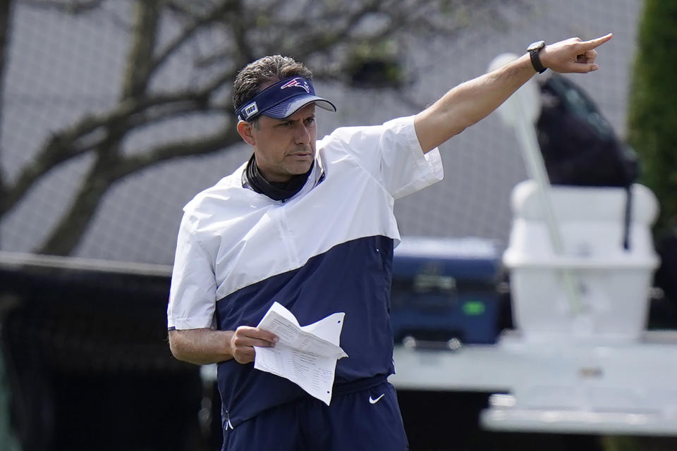 FILE - In this Aug. 26, 2020, file photo, New England Patriots quarterback coach Jedd Fisch coaches players during NFL football training camp in Foxborough, Mass. Arizona is hiring New England Patriots assistant Jedd Fisch as its head coach, a person with knowledge of the situation told The Associated Press on Wednesday, Dec. 23, 2020. Fisch is filling the vacancy created when Arizona fired Kevin Sumlin earlier this month after the Wildcats finished the season winless, according to the person who spoke to the AP on condition of anonymity because the school was still preparing an official announcement. (AP Photo/Steven Senne, Pool, File)