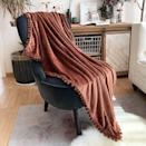<p>The <span>Lomao Flannel Blanket With Pompom Fringe </span> ($32) is a gorgeous lightweight throw blanket that will instantly give your environment that cozy fall vibe. It comes in a variety of colors so you can get a few for your home. </p>