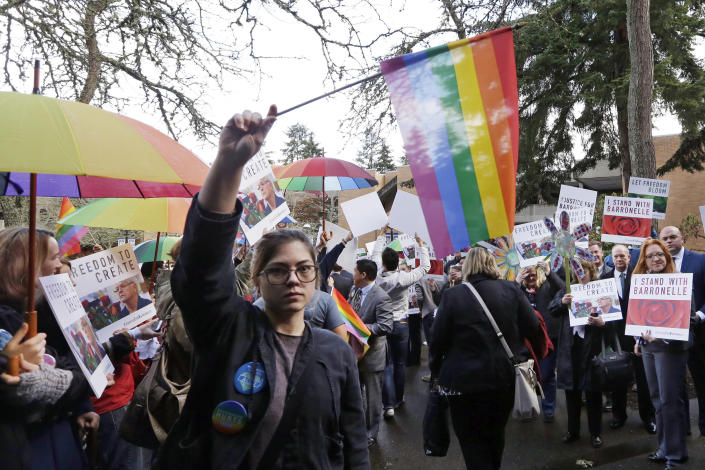 Image: Supporters on both sides of the case line a walkway following a hearing before Washington's Supreme Court about a florist, Barronelle Stutzman, who was sued for refusing to provide services for a same sex-wedding on Nov. 15, 2016, in Bellevue, Wash (Elaine Thompson / AP file)