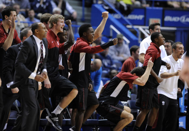 Stanford players celebrate late in their team's 53-51 victory over Connecticut in an NCAA college basketball game in Hartford, Conn., Wednesday, Dec. 18, 2013. (AP Photo/Fred Beckham)