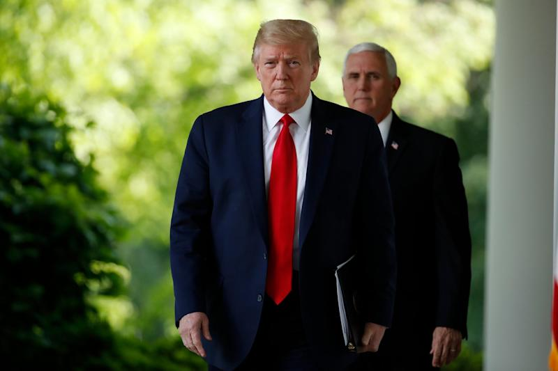 Donald Trump and Mike Pence arrive at a press conference on the coronavirus pandemic at the White House: AP