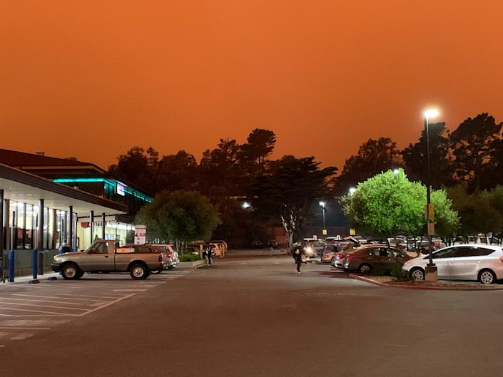 The parking lot of a Safeway supermarket in San Francisco's Diamond Heights neighborhood on Wednesday, September 9, 2020 at 11:15 am. The reddish-orange tinge to the sky is from multiple wildfires in the region.