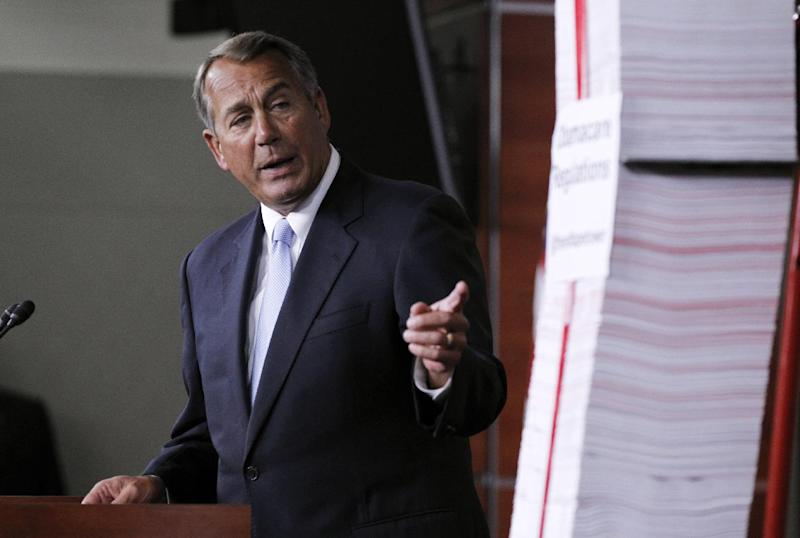 FILE - In this May 16, 2013 file photo, House Speaker, Republican John Boehner of Ohio, points toward the tall stack of paper, representing 20,000 pages of Affordable Care Act regulations, during a news conference on Capitol Hill in Washington. The health care law has been a political prop for two election seasons already, but next year will be different. if the rollout of the law works reasonably well, particularly in states that have embraced it, there is an risk for Republicans, who have touted it as such a disaster that enraged voters will reward the GOP with undisputed control of Congress in next year's elections. (AP Photo/Molly Riley, File)