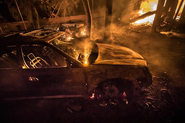 <p>A car burns on Wednesday in Kenwood, Calif, on Oct. 11, 2017. (Photo: Paul Kuroda via ZUMA Wire) </p>