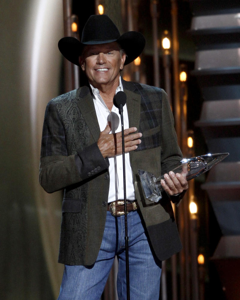 George Strait accepts the award for entertainer of the year at the 47th annual CMA Awards at Bridgestone Arena on Wednesday, Nov. 6, 2013, in Nashville, Tenn. (Photo by Wade Payne/Invision/AP)