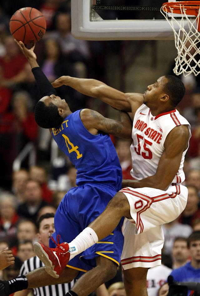 Delaware's Jarvis Threatt, left, goes up to shoot against Ohio State's Trey McDonald during the second half of an NCAA college basketball game in Columbus, Ohio, Wednesday, Dec. 18, 2013. Ohio State won 76-64. ( AP Photo/Paul Vernon)