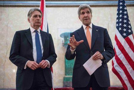 U.S. Secretary of State John Kerry (R) and Britain's Foreign Secretary Philip Hammond address the media at the donors Conference for Syria in London, Britain February 4, 2016. REUTERS/Nicholas Kamm/pool