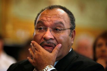 FILE PHOTO: Papua New Guinea's then Prime Minister Peter O'Neill pauses before making an address to the Lowy Institute in Sydney, Australia November 29, 2012.      REUTERS/Tim Wimborne/File Photo