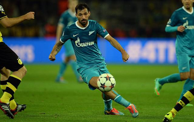 Zenit's Portuguese midfielder Miguel Danny (C) plays the ball during the last 16 second-leg UEFA Champions League football match Borussia Dortmund vs Zenit St Petersburg in Dortmund, western Germany on March 19, 2014 (AFP Photo/Patrik Stollarz)