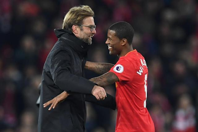 Liverpool's manager Jurgen Klopp (L) celebrates with goalscorer Liverpool's Georginio Wijnaldum after the English Premier League football match between Liverpool and Manchester City at Anfield in Liverpool, north west England on December 31, 2016 (AFP Photo/Paul ELLIS)