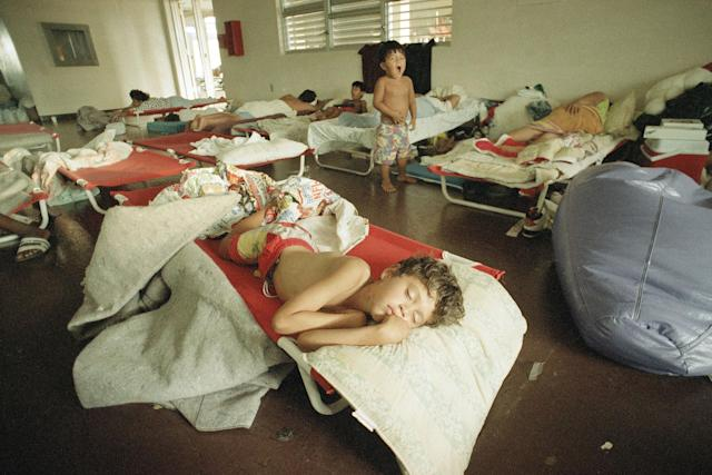<p>Jesus Cruz, 7, sleeps on a cot at a Red Cross shelter in Homestead, Fla., Aug. 29, 1992. His family had saved their money for years to buy a home in nearby Florida City only 3 months ago but they lost everything they had when Hurricane Andrew devastated the area last Monday. (AP Photo/Rick Bowmer) </p>