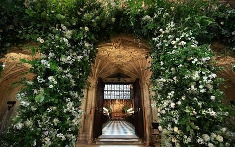 Flowers adorn the front of the organ loft inside St George's Chapel at Windsor Castle - Credit: Danny Lawson/PA