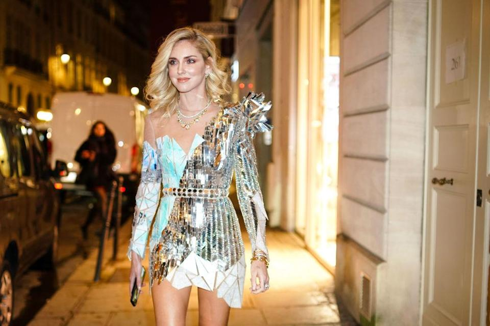 Chiara Ferragni wears a silver shiny dress with geometric patterns, outside Balmain, during Paris Fashion Week – Haute Couture Spring Summer 2020, on January 23, 2019 in Paris, France. (Photo by Edward Berthelot/Getty Images)