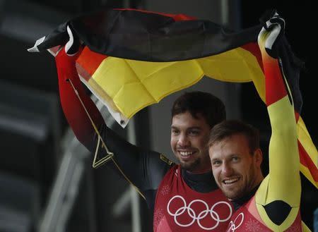 Luge – Pyeongchang 2018 Winter Olympics – Men's Doubles competition – Olympic Sliding Centre - Pyeongchang, South Korea – February 14, 2018 - Tobias Wendl and Tobias Arlt of Germany celebrate winning gold. REUTERS/Edgar Su