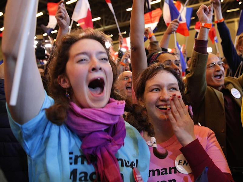 Macron supporters celebrating the results (AP)