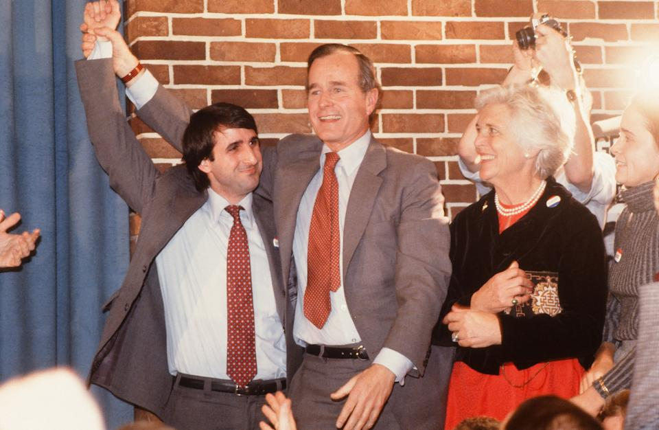 George H.W. and Barbara Bush celebrate with an unidentified man at an Iowa event during the future president's unsuccessful run for the Republican presidential nominationin January 1980.