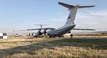 This photo taken from the footage provided by Russian Defense Ministry press service on Tuesday, Nov. 10, 2020 shows Russian military planes with peacekeepers on boards after landing at Erebuni Airport outside Yerevan, Armenia. More than a dozen planes carrying Russian peacekeepers headed for Nagorno-Karabakh on Tuesday, hours after Armenia and Azerbaijan agreed to halt fighting over the separatist region and amid signs this cease-fire would hold where others hadn't. (Russian Defense Ministry Press Service via AP)