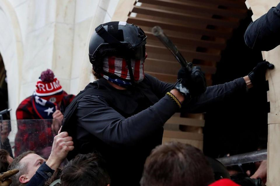 Pro-Trump rioters clash with Capitol police on 6 January.