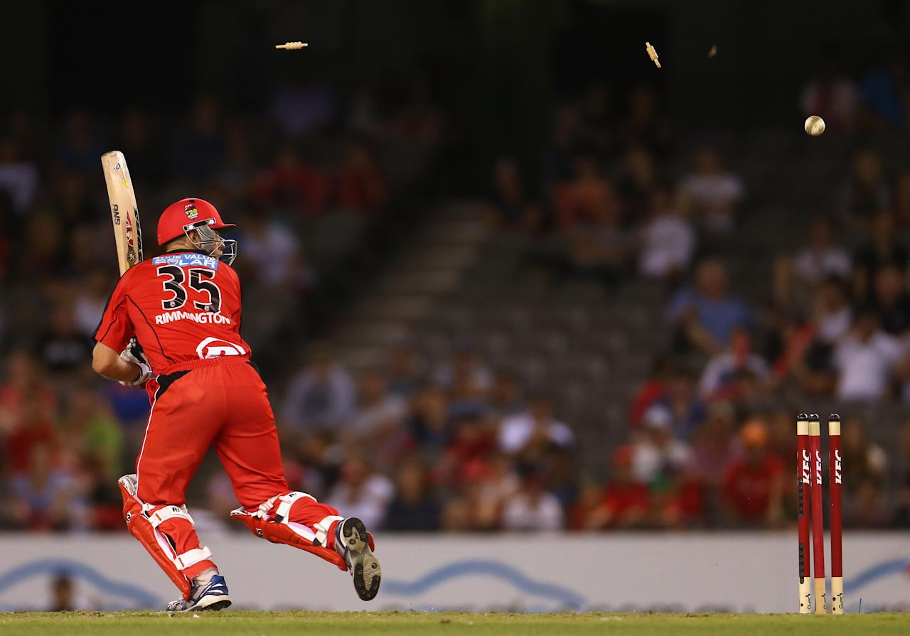 MELBOURNE, AUSTRALIA - JANUARY 15: Nathan Rimmington of the Renegades is bowled by Ben Cutting of the Heat during the Big Bash League Semi-Final match between the Melbourne Renegades and the Brisbane Heat at Etihad Stadium on January 15, 2013 in Melbourne, Australia.  (Photo by Robert Cianflone/Getty Images)