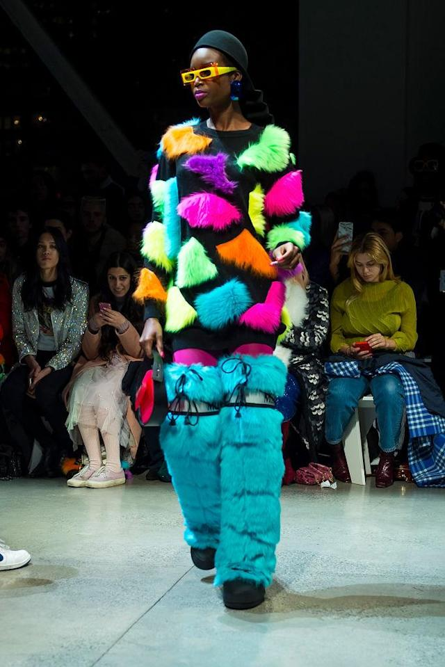 <p>Model wears thigh-high blue moon boots with her colorful furry sweater at Jeremy Scott's Fall 2018 show. (Photo: Getty) </p>